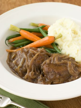 offal: Faggots in Onion Gravy with Mashed Potato and Vegetables