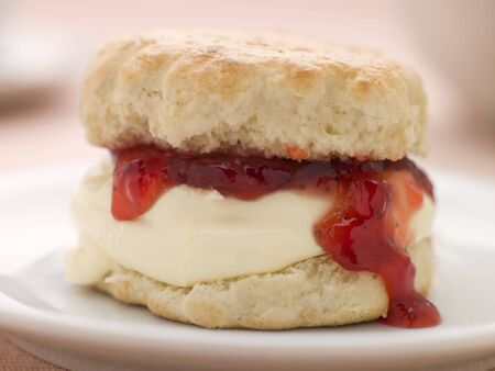 Scone Filled with Strawberry Jam and Clotted Cream on a plate Stock Photo - 3443489