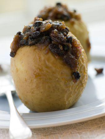christmas pudding: Baked Apples stuffed with Christmas Pudding Stock Photo