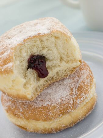 spreads: Two Raspberry Jam Doughnuts with a bite