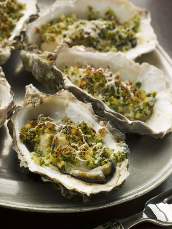 seafood platter: Platter of Oysters Rockefeller Stock Photo