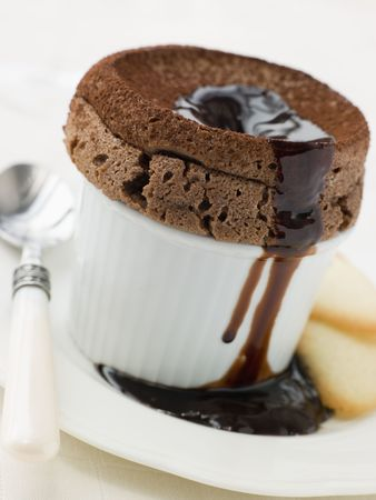 Hot Chocolate Souffle with Chocolate sauce and Langue de Chat Biscuits photo