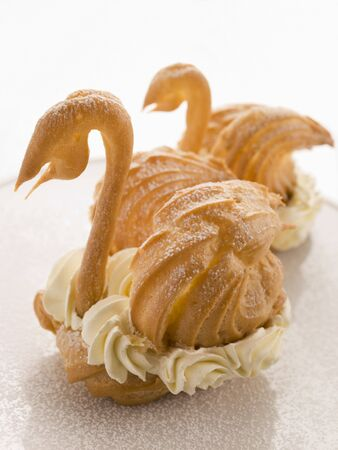 chantilly: Two Choux Swans filled with Chantilly Cream Stock Photo