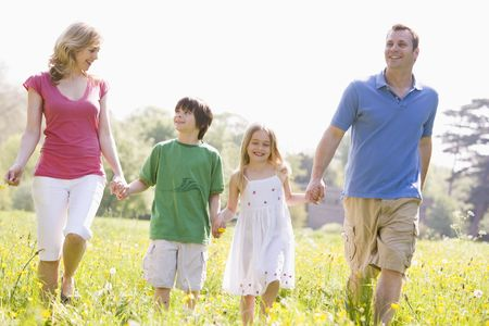 Family walking outdoors holding flower smiling photo