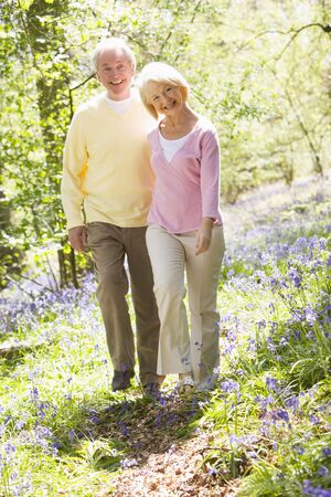 oap: Couple walking outdoors smiling