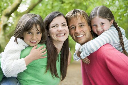Family outdoors smiling Stock Photo - 3476885