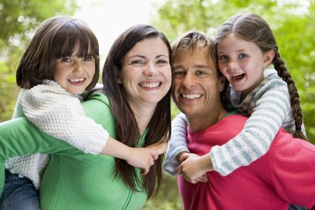 Family outdoors smiling Stock Photo - 3477276