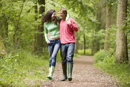 wellies: Couple walking on path arm in arm Stock Photo