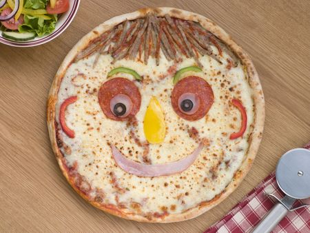 overhead view: Smiley Faced Pizza with a Side Salad