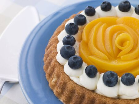 Whipped Cream Peach and Blueberry Sponge Flan photo