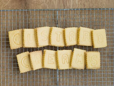 Custard Cream Biscuits on a Cooling Rack Stock Photo - 3477303
