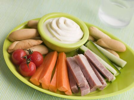 childrens meal: Ham Vegetable and Bread Sticks with Cheese Spread Stock Photo