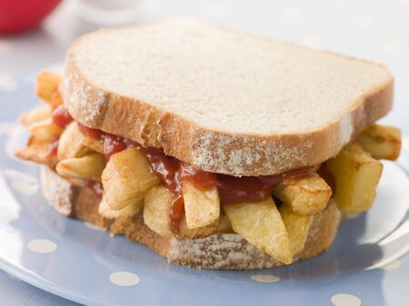 tomato catsup: Chip Sandwich on White Bread with Tomato Ketchup