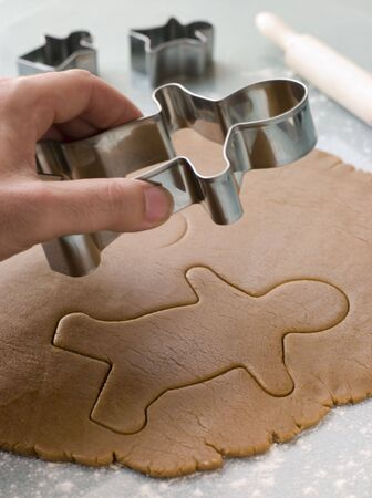 Cutting out a Gingerbread Man photo