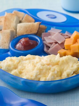 catsup: Scrambled Egg with Toast Ham and Cheese Squares