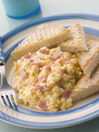 Cheesy Scrambled Egg with Ham and Toasted Triangles Stock Photo - 3600275