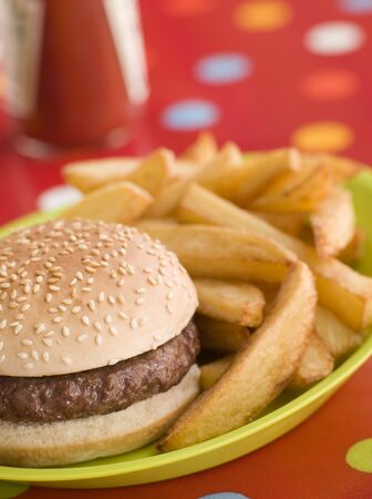 Beefburger in a Sesame Seed Bun with Chunky Chips Stock Photo - 3600140
