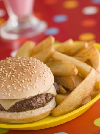 childrens food: Cheeseburger in a Sesame Seed Bun with Chunky Chips