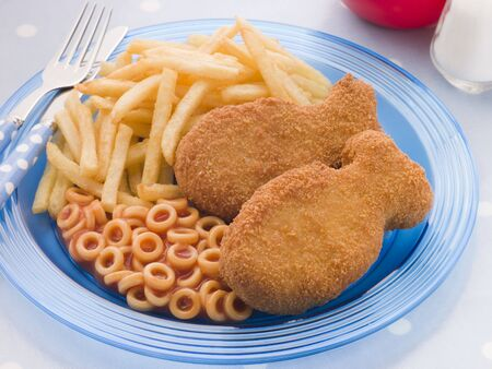 childrens meal: Fish Cakes with Spaghetti Hoops and Chips Stock Photo