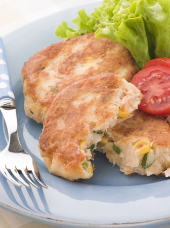 childrens food: Cod and Salmon Fish Cakes with Corn and Salad
