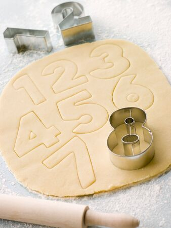 childrens meal: Cutting out Number Shape Biscuits