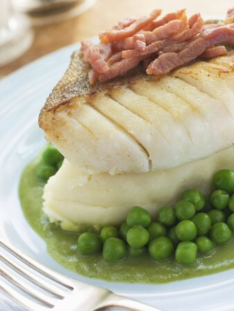 uk cuisine: Roasted Cod Fillet with Mash Potato Peas and bacon