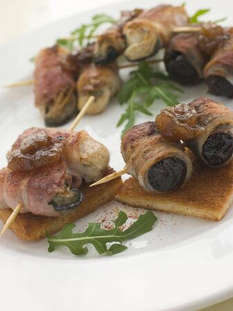 roquette: Angels and Devils on Horseback on Toasts Stock Photo