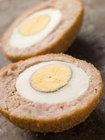 breadcrumbs: Scotch Egg cut in half Stock Photo
