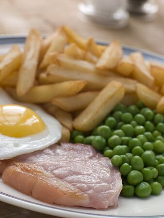 Gammon Steak Fried Egg Peas and Chips photo