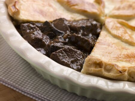 uk cuisine: Steak and Ale Pie with Short Crust Pastry Stock Photo