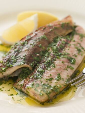 edible fish: Loch Fyne Kippers Grilled with Parsley Butter Stock Photo