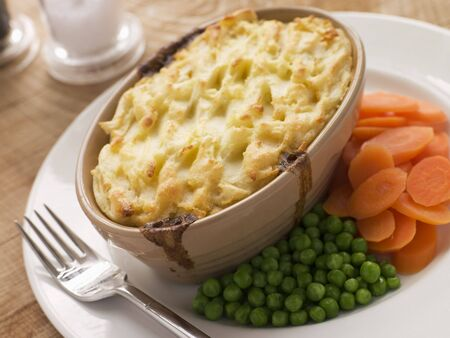 Individual Cottage Pie with Peas and Carrots photo