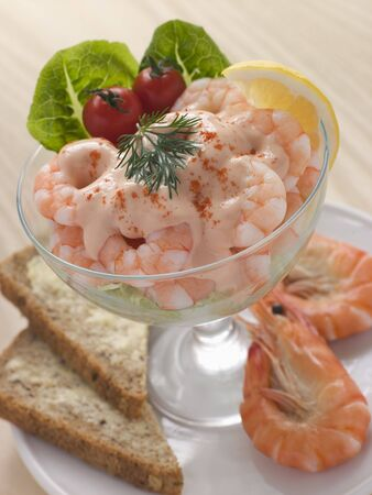 prawn: Prawn Cocktail in a glass with Brown Bread