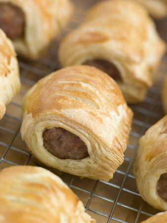 uk cuisine: Sausage Rolls on a Cooling Rack Stock Photo