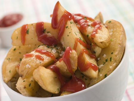 wedges: Bowl of Potato Wedges and Tomato Ketchup