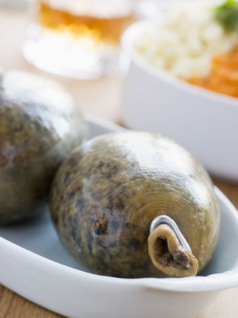 uk cuisine: Whole Haggis with Neeps Tatties and Whiskey