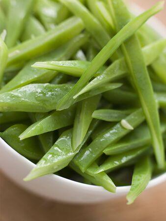 uk cuisine: Bowl of Green Runner Beans Stock Photo