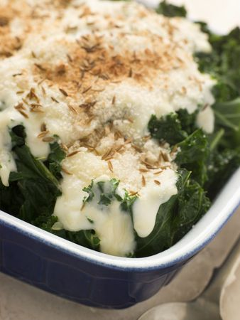 breadcrumbs: Curly Kale with Cheese Sauce Caraway Seeds and Breadcrumbs Stock Photo