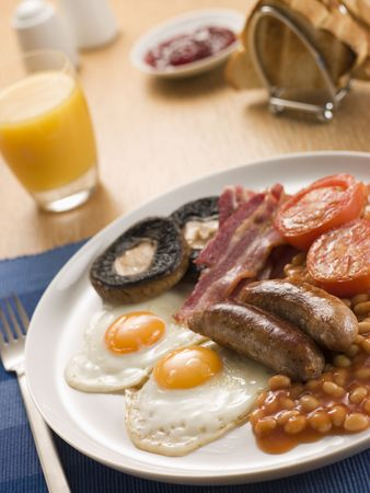 Full English Breakfast with Orange Juice Toast and Jam photo