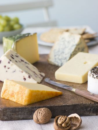 Selection of British Cheeses with Walnuts Biscuits and Grapes photo