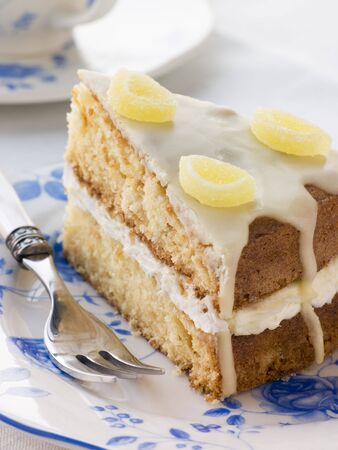 butter icing: Slice of Lemon Drizzle Cake Stock Photo
