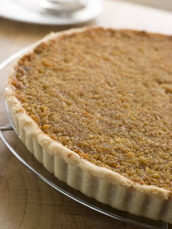 treacle: Whole Treacle Tart on a Cooling Rack