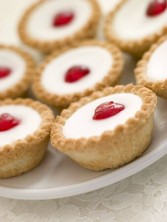Plate of Cherry Bakewell Tarts photo