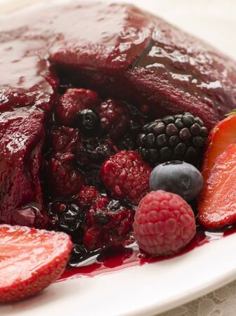 summer pudding: Traditional Summer Pudding with a scoop out