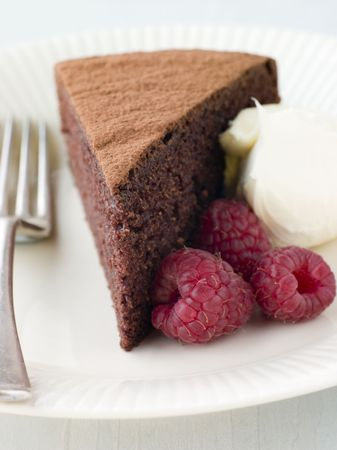 Chocolate Sponge with Whipped Cream and Raspberries photo