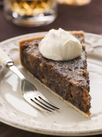 slagroom: Whiskey en gedroogde vruchten taart met slagroom