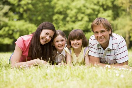 Family outdoors smiling photo
