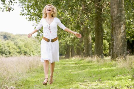 healthy path: Woman walking on path smiling