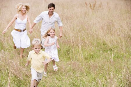 Family running outdoors smiling Stock Photo - 3600260