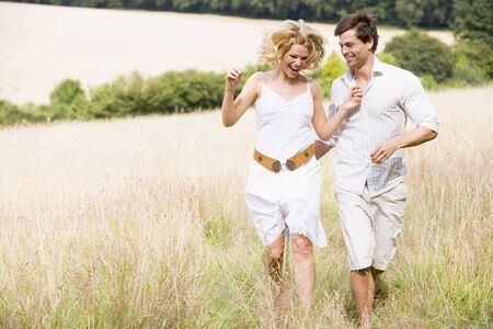 Couple running outdoors smiling photo